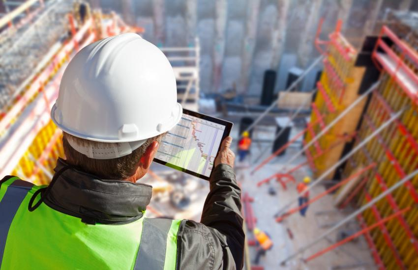 Construction professional overlooking erection site